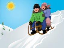 sledding śmieszni dzieciaki Zdjęcia Stock