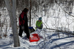 Sledding in Minnesota. Children sledding in Minnesota's deep snow Royalty Free Stock Image