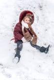 Sledding op sneeuw Stock Foto's