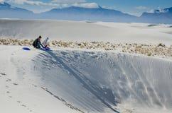 Sledding on Sand Dunes - New Mexico royalty free stock photos