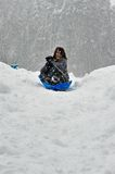 Sledding on a saucer Stock Image