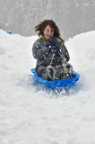 Sledding on a saucer Royalty Free Stock Photo