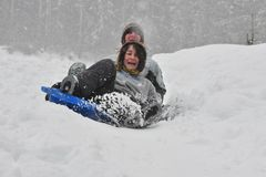 Sledding on a saucer Royalty Free Stock Photography