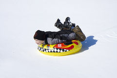 Sledding in Snow Stock Images
