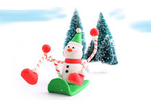 Sledding snowman Royalty Free Stock Image