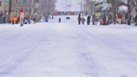 Sledding Time Lapse Sequence. V1. Three clips of time lapse of people sledding down hill in Seattle stock footage