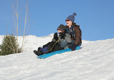 Sledding together Stock Image