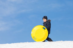 Sledding at winter time Stock Photo