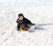 Sledding at winter time Stock Photos