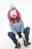 Sledding at winter time Stock Image