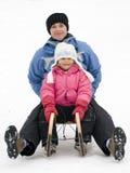 Sledding at winter time Royalty Free Stock Image