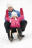Sledding at winter time Stock Photos