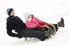 Sledding at winter time Royalty Free Stock Photos