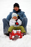 Sledge. Mother with daughter sliding on sledge royalty free stock image