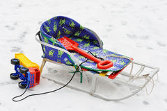 Sledge, children's paddle, and toy truck Royalty Free Stock Photography