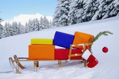 Sledge with Christmas presents in winter landscape Stock Photos