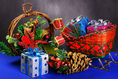 Sledge with gifts and garland Royalty Free Stock Photography