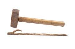 Sledge hammer and iron rod Stock Image