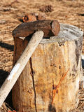 Sledge hammer on log Stock Photo