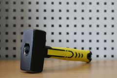 Sledge hammer with rubberized handle in yellow color, 1 kg royalty free stock photos