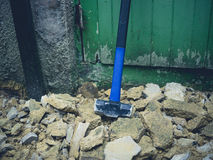Sledge hammer and rubble. A sledge hammer and rubble outside Royalty Free Stock Image