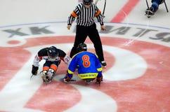 Sledge hockey face-off. PODOLSK, RUSSIA - JANUARY 14, 2017: Unidentified players of Ladoga (blue) and Zvezda (white)  team of Sledge hockey Royalty Free Stock Photos