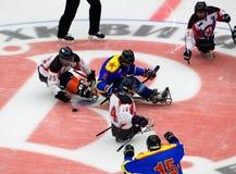 Sledge hockey face-off. PODOLSK, RUSSIA - JANUARY 14, 2017: Unidentified players of Ladoga (blue) and Zvezda (white)  team of Sledge hockey Royalty Free Stock Image