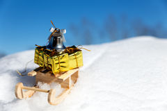 Sledge with little gifts and bell in the snow Stock Photo