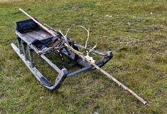 Sledge on a meadow in the summer. With a pole and a skull of a deer Stock Image