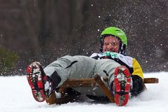 Sledge race. Horned sledge race in Slovakia. Championship tournament in Turecka. High speed traditional downhill 2015 Stock Photo