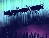 Sledge of Santa fly on polar light Stock Photo