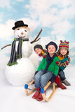 Sledge and snowman fun Royalty Free Stock Photo