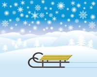 Sledge in winter landscape. With a lot of snowflakes Stock Photography