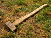 Sledgehammer on withered grass Royalty Free Stock Photo