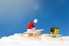 Sledges with a pointed cap and a gift in the snow Royalty Free Stock Photo