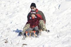 sledging χειμώνας διασκέδασης Στοκ Εικόνες
