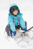 Sledging in a blizzard Royalty Free Stock Photos