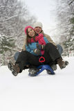 Sledging couple Royalty Free Stock Images