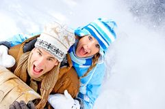 Sledging couple Stock Photos
