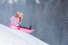 Sledging downhill Royalty Free Stock Image