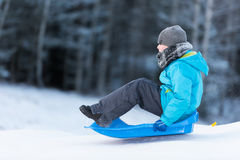 Sledging downhill with speed Royalty Free Stock Image