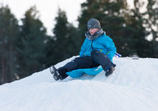 Sledging downhill Royalty Free Stock Photos