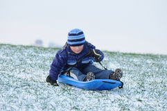 Sledging on first snow stock image