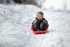 Sledging nella neve Fotografie Stock Libere da Diritti