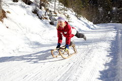 Sledging on a sunny winter day Stock Images