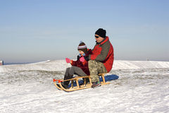 Sledging - winter fun Stock Photos