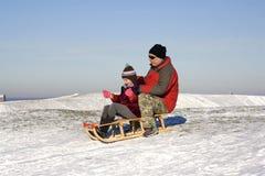 Sledging - winter fun Stock Photos