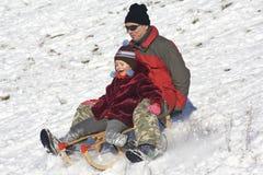 Sledging - winter fun Royalty Free Stock Image