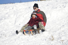 Sledging - winter fun Stock Photo