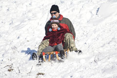 Sledging - winter fun Stock Images
